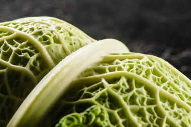 close-up view of fresh healthy savoy cabbage on black