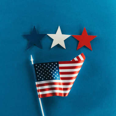 close up view of stars and american flag isolated on blue, presidents day concept