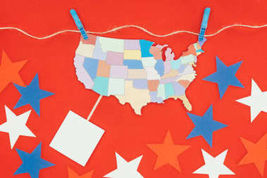 top view of piece of map with usa states hanging on rope and stars isolated on red