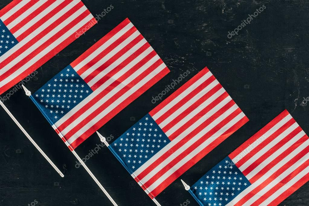 top view of arranged american flags on dark surface, presidents day concept