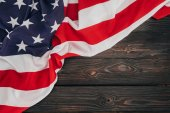 Fotografie top view of folded american flag on dark wooden tabletop, presidents day concept