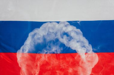 close up view of russian flag and smoke background