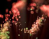 Fotografie Selektivní fokus z optických vláken lesklé růžové pozadí