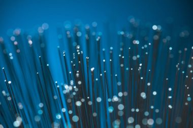 selective focus of blue fiber optics texture background