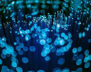 selective focus of glowing blue fiber optics texture with bokeh