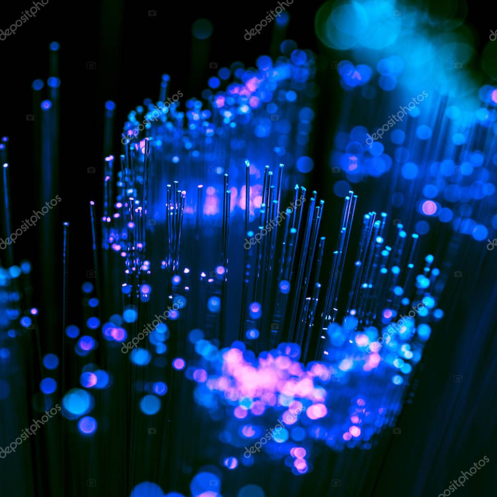 selective focus of shiny blue and purple fiber optics background, communication technology