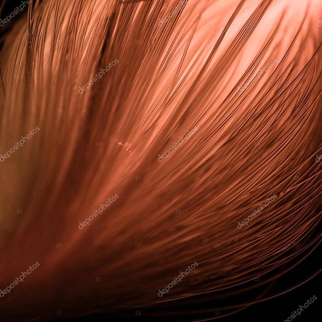 close up of glowing pink fiber optics threads texture