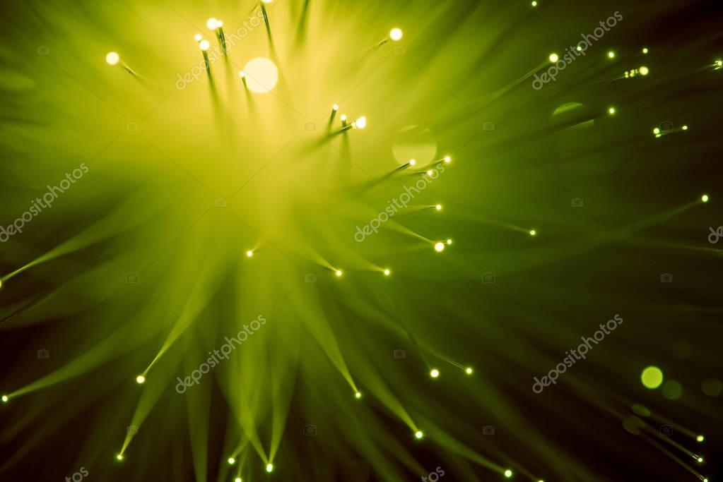 top view of glowing yellow fiber optics background