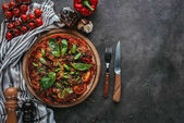 Fotografie top view of delicious pizza with fork and knife on concrete table
