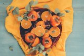 Fotografie top view of fruits on plate on orange tablecloth