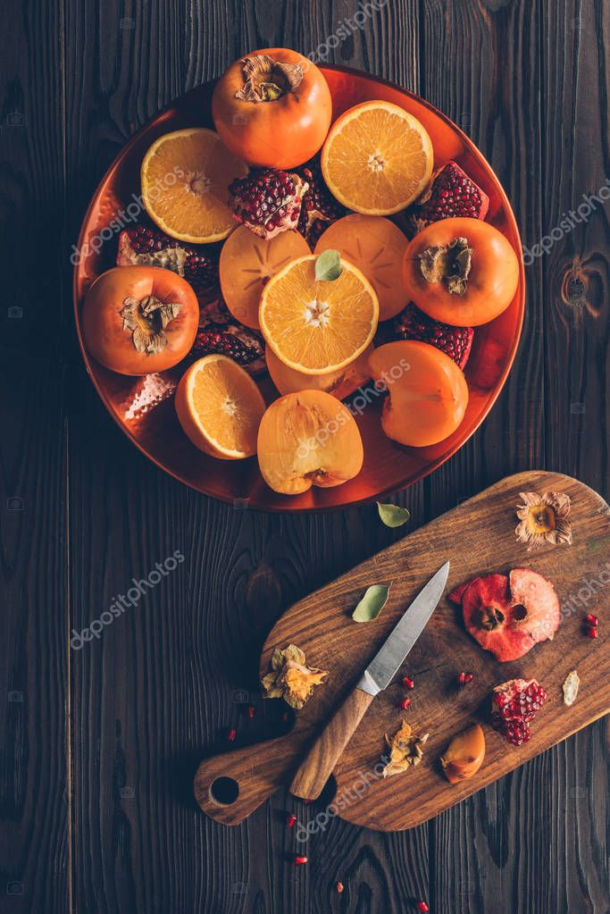 top view of plate with cut delicious fruits