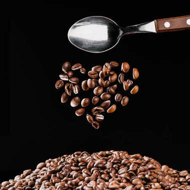 heart shaped coffee beans isolated on black, st valentine day concept