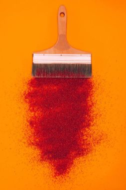 Top view of red sand for decoration and brush isolated on orange stock vector