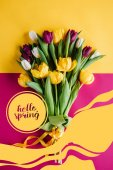 Fotografie top view of spring tulips with HELLO SPRING sign