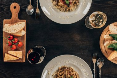 top view of plates with different pasta on table at restaurant