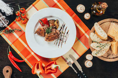 top view of grilled vegetables and chicken on wooden table