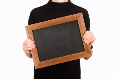 Partial view of woman holding empty blackboard isolated on white stock vector