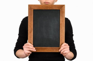 Cropped image of woman holding empty chalkboard isolated on white