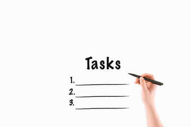 cropped image of woman writing tasks inscription isolated on white