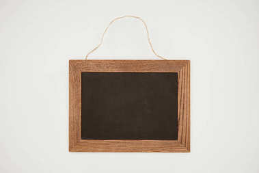 blank chalkboard with wooden frame and thread isolated on white