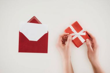 Cropped shot of woman opening gift box with red envelope isolated on white stock vector