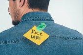 Fotografie Rückansicht des Mannes mit Hinweis auf Klebeband mit kick mich Schriftzug auf Rückseite, Aprilscherze Tag Ferienkonzept