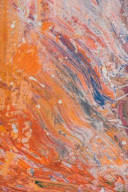 close up of multicolor texture with oil paint splatters