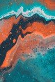 Fotografie zblízka abstraktní pozadí s modrými a oranžovými Akrylová barva