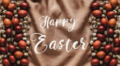 top view of easter painted eggs and quail eggs on linen tablecloth with Happy Easter lettering