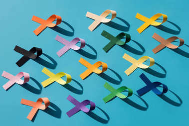 flat lay with arranged colorful ribbons isolated on blue, world health day concept