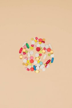 top view of medicines arranged in circle isolated on beige, world health day concept