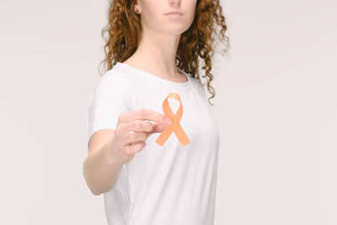 cropped shot of woman showing leukemia, kidney cancer, multiple sclerosis RSD awareness ribbon in hand isolated on white