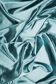 Photo turquoise shiny crumpled satin fabric background