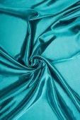 turquoise shiny satin fabric background