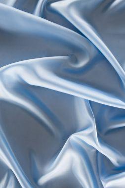 Blue shiny satin fabric background