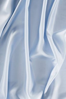 light blue shiny satin fabric background