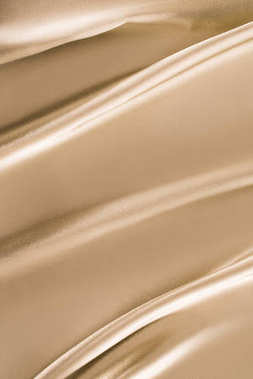 beige shiny satin fabric background