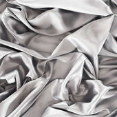silver crumpled shiny silk fabric background