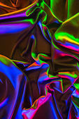 colored crumpled shiny silk fabric background