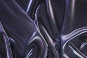 sötét lila fényes selyem szövet háttér
