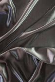 Zelené a stříbrné elegantní hedvábné tkaniny pozadí