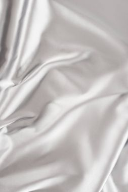 light silver crumpled shiny silk fabric background