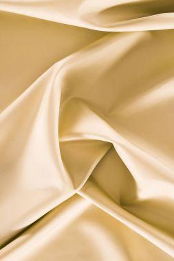 Beige crumpled shiny silk fabric background stock vector