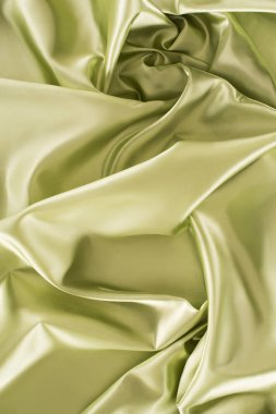 green shiny silk fabric background