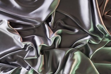 silver and green soft silk fabric background
