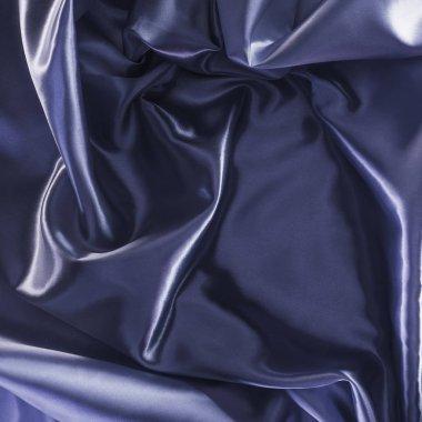 dark violet shiny satin fabric background
