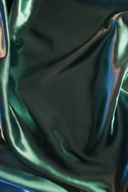 green shiny elegant silk fabric background