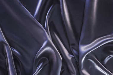 dark violet shiny silk fabric background