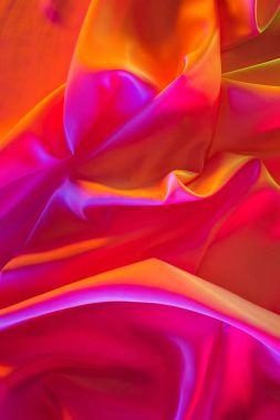 pink and orange shiny silk fabric background