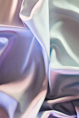 green and violet shiny silk fabric background